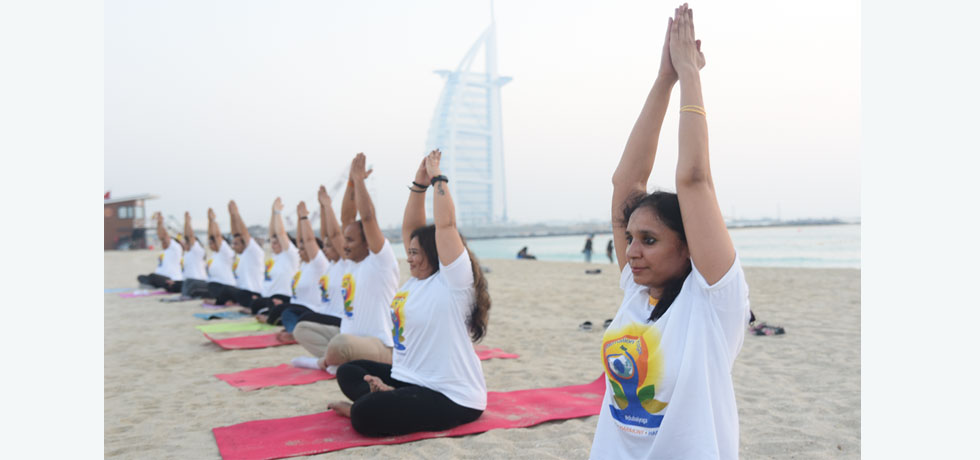 Yoga practice ahead of 5th International Day of Yoga, overlooking the Burj Al Arab, an iconic sail-shaped building in Dubai.
